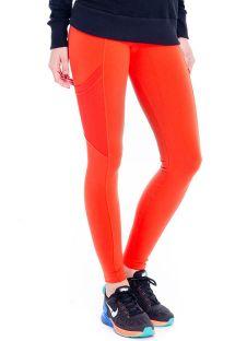 Ciemnopomarańczowe legginsy do fitnessu z ażurowymi kieszeniami - FUSEAU YACATAS