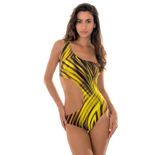 f1012c83e701e One piece asymmetrical swimsuit with a golden yellow print - LUXOR  ASSIMETRICO