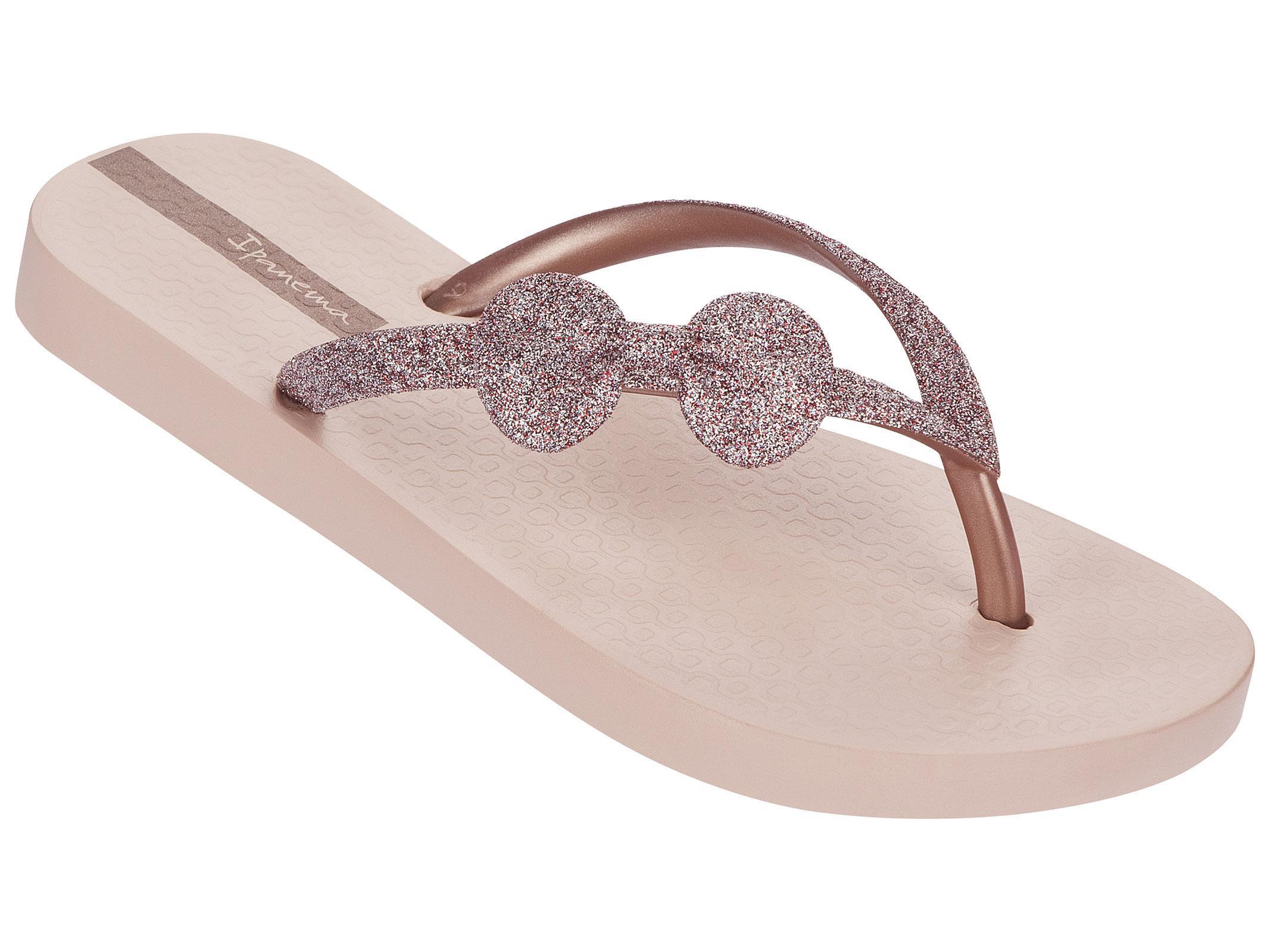 light pink flip flops featuring glitter straps with bow. Black Bedroom Furniture Sets. Home Design Ideas