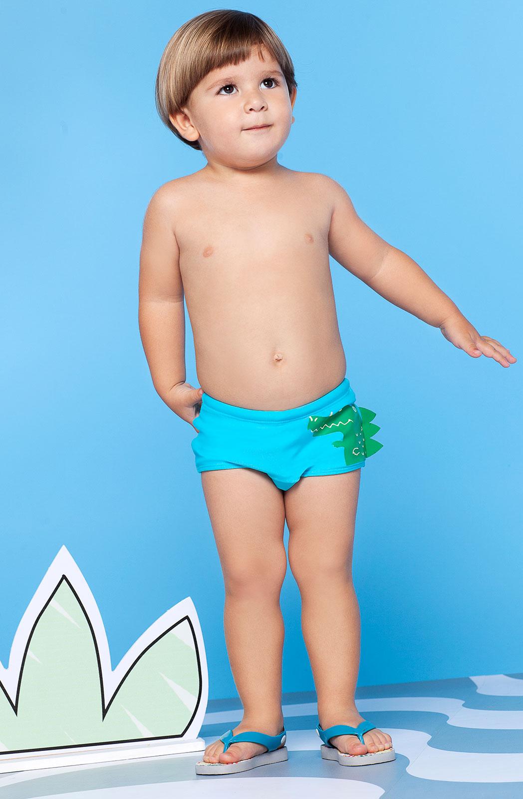 costume da bagno azzurro per bambini motivo con coccodrillo in rilievo jacare