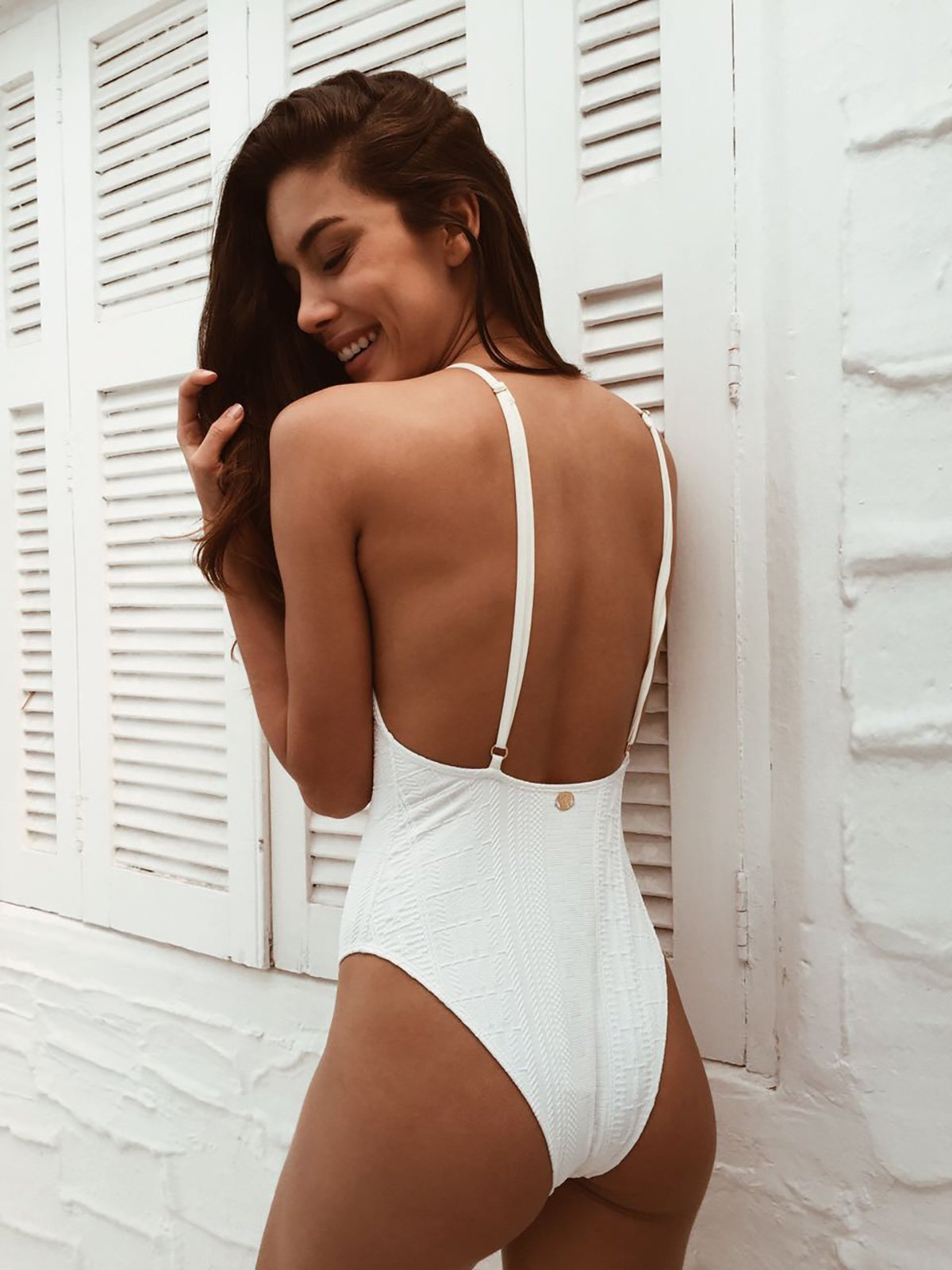 one-piece white textured swimsuit with adjustable straps - body side